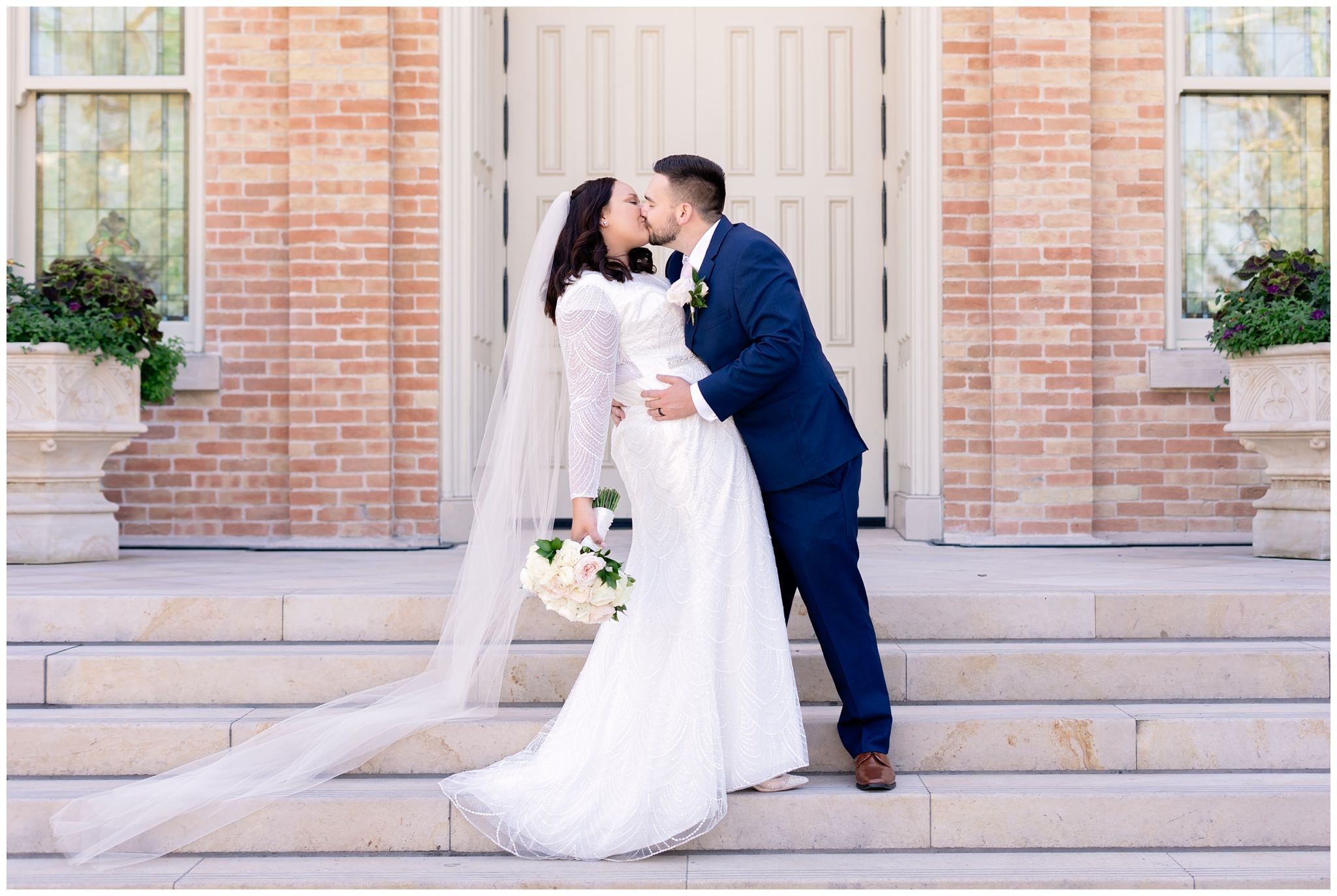 Bride and groom kissing on Temple steps