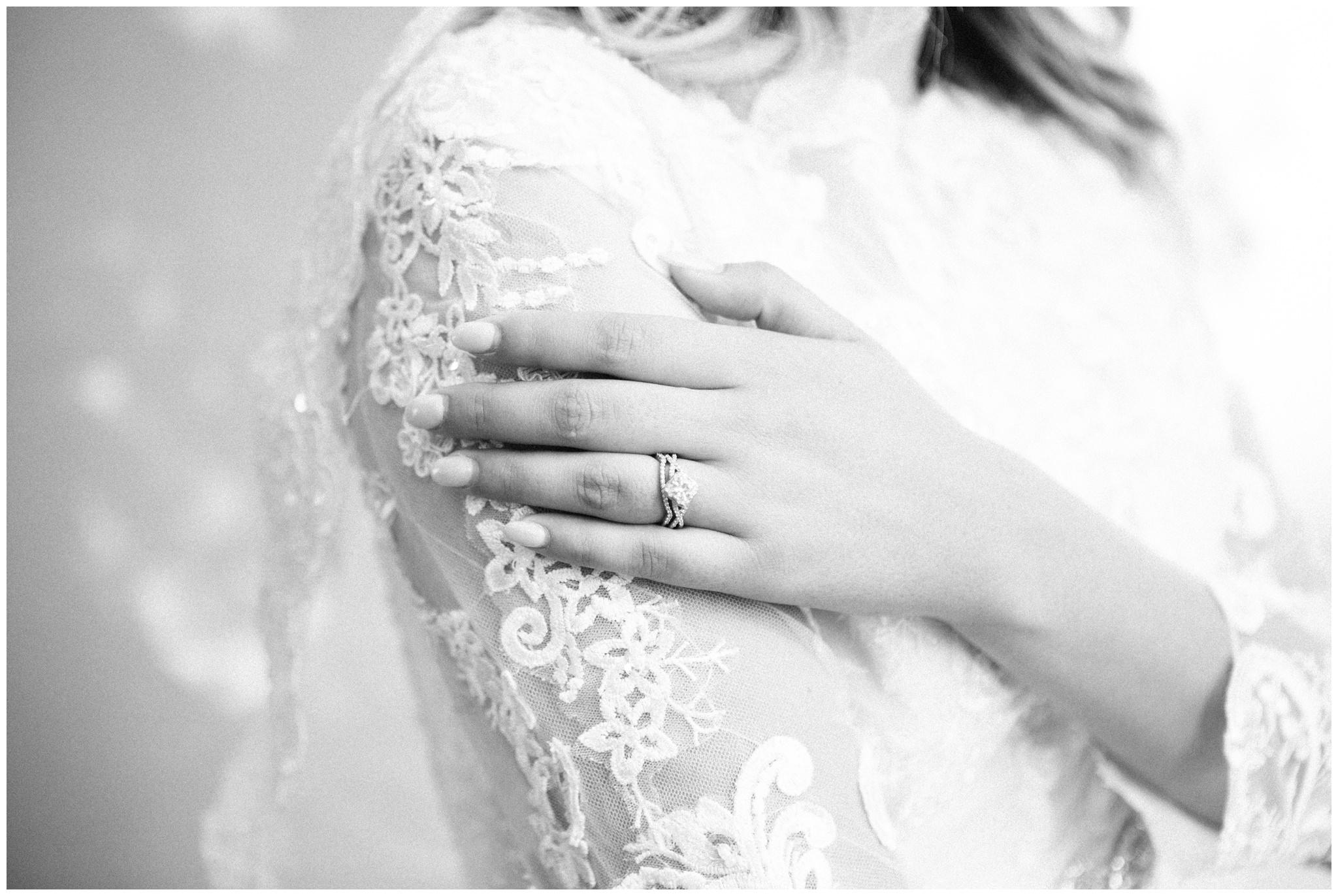 Wedding Ring detail shot on Wedding Dress