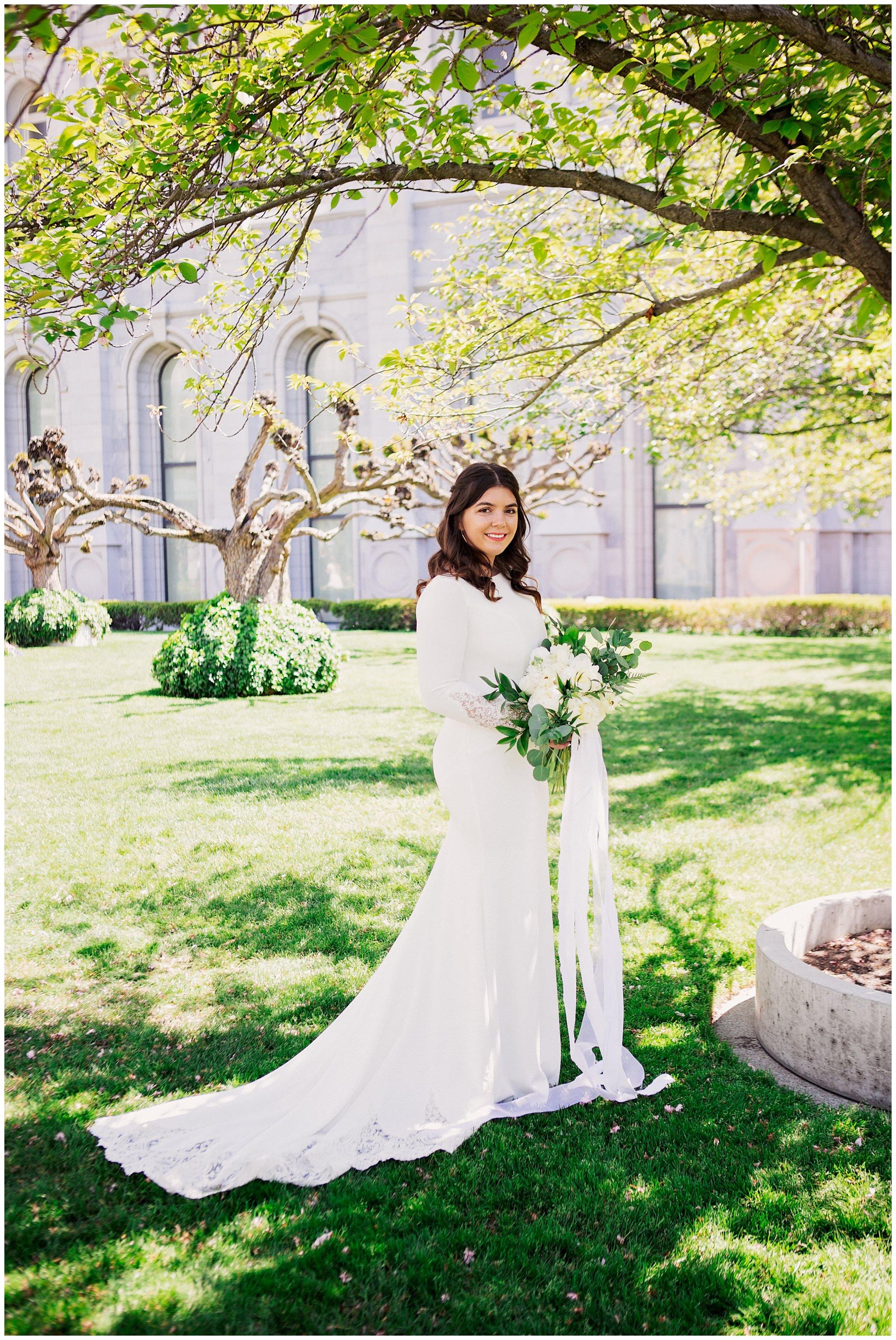 Bride smiling at Camera at her wedding in SLC Utah