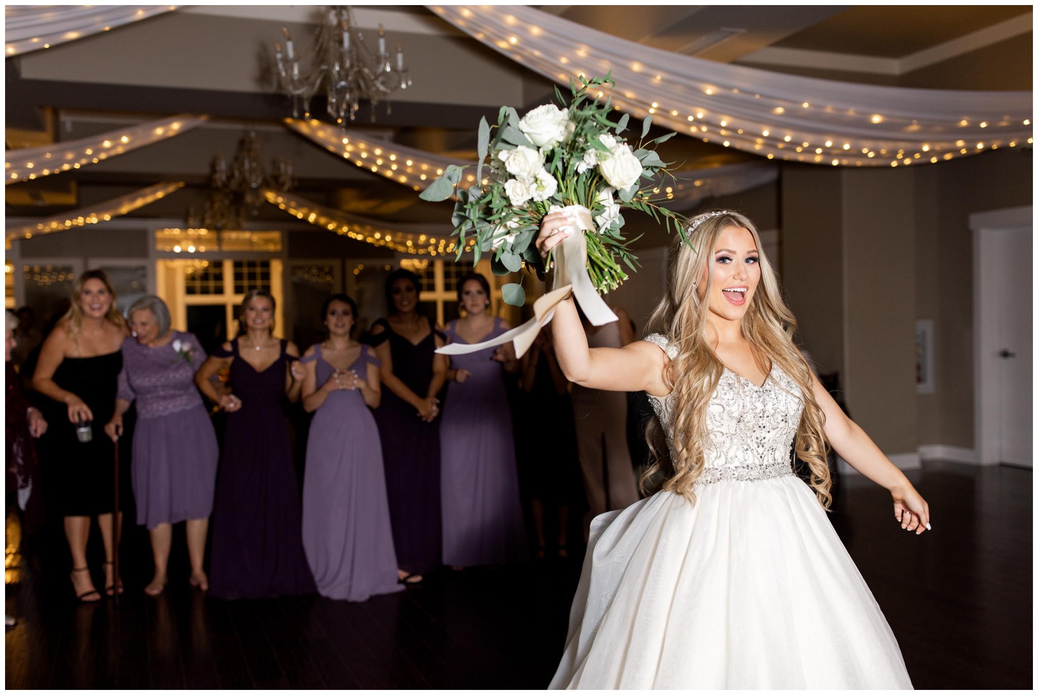 Bride tossing bouquet at Utah wedding