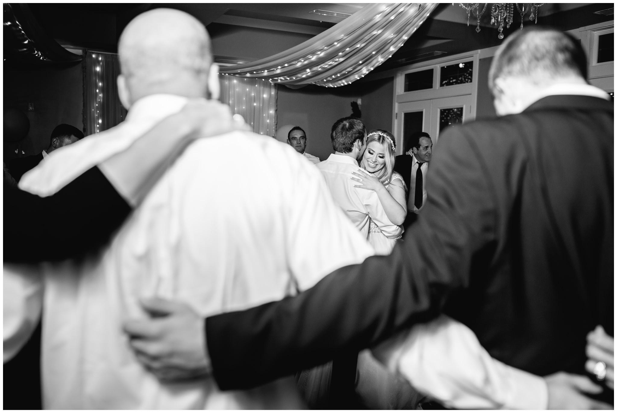 Bride and groom dancing at their wedding in Utah county