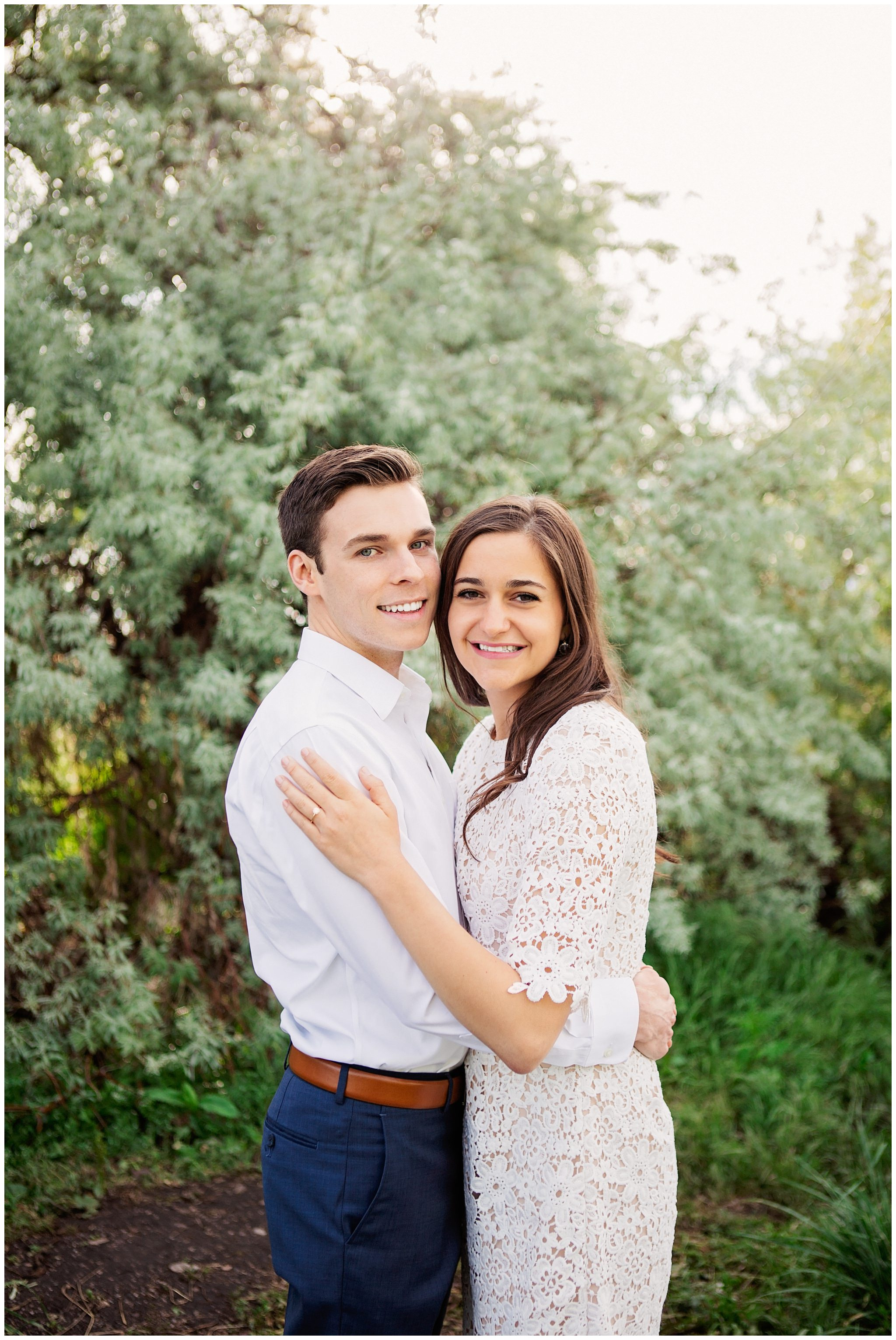 Couple smiling at camera for their engagement session in Salt Lake City Utah