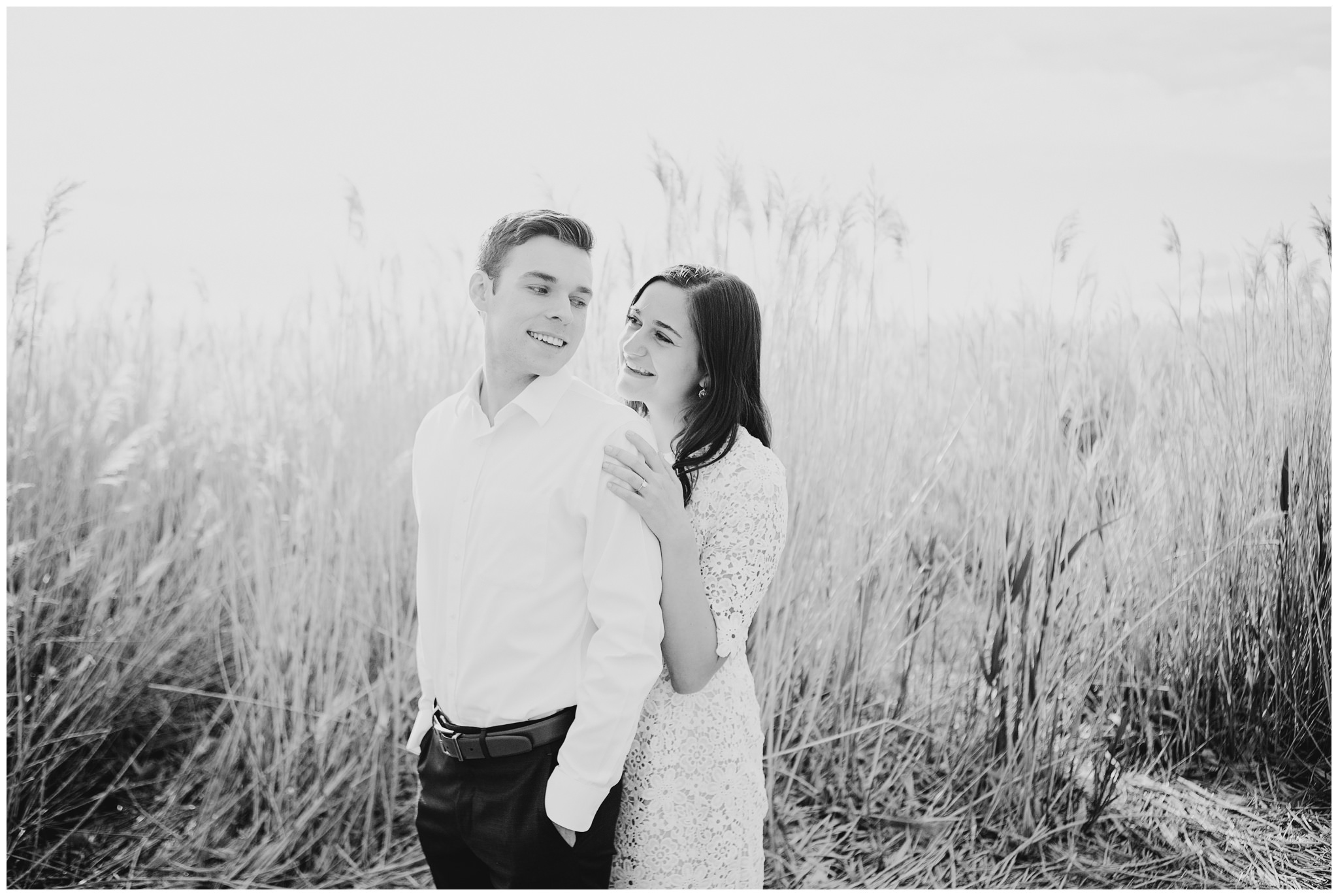Couple snuggling near Utah Lake