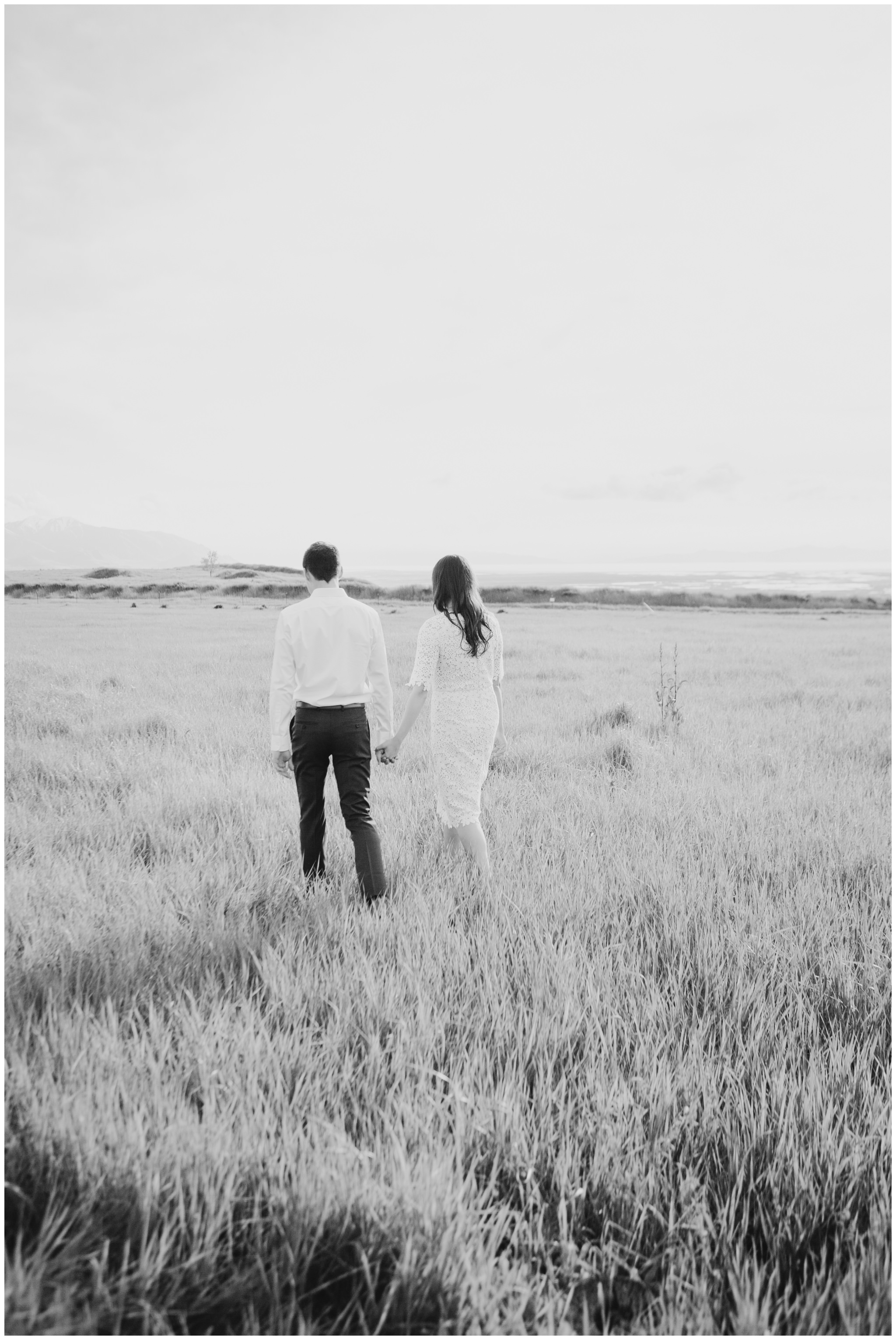 Black and White image of couple walking away together