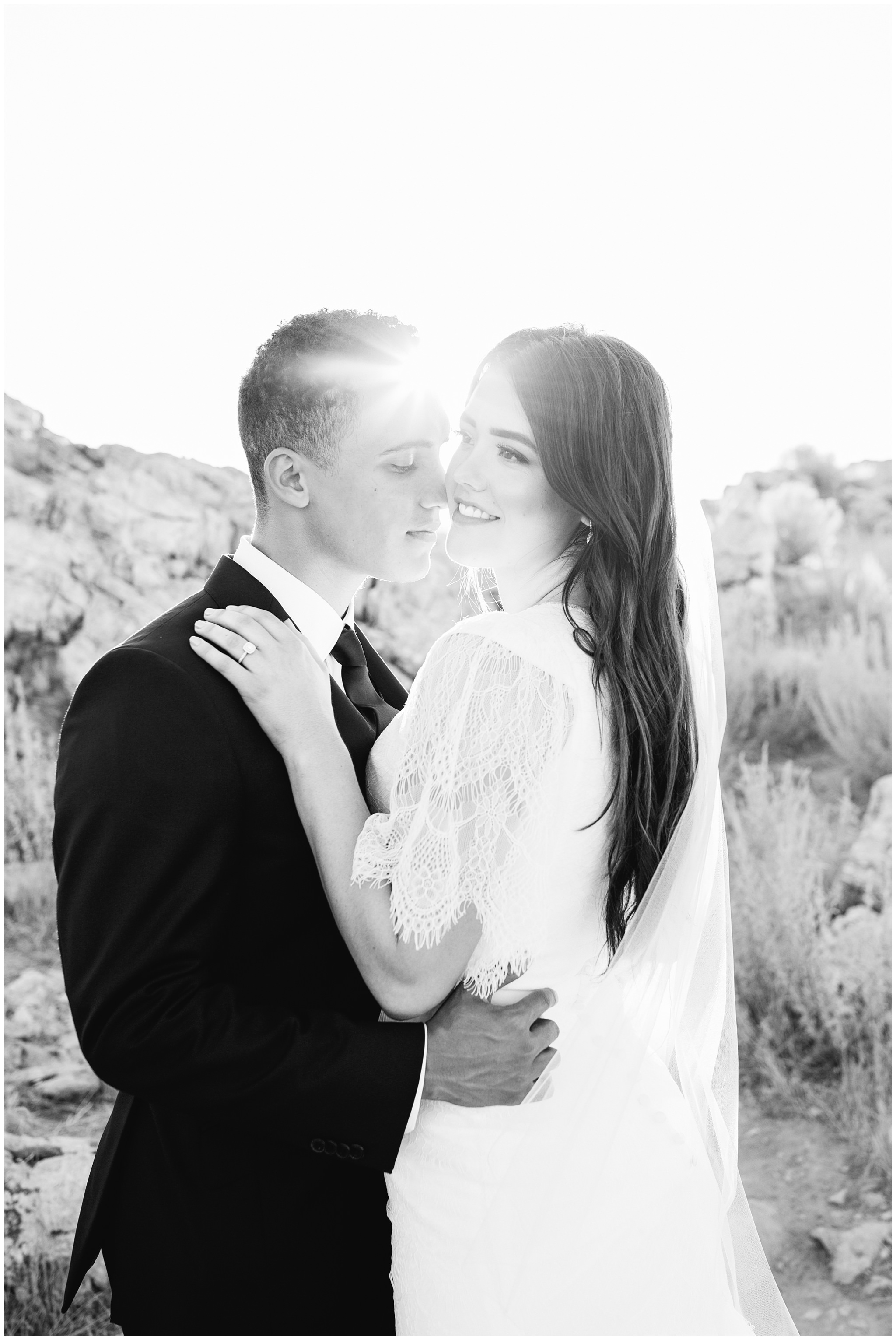 Groom tickling bride with his nose making her laugh for the wedding pictures in Utah