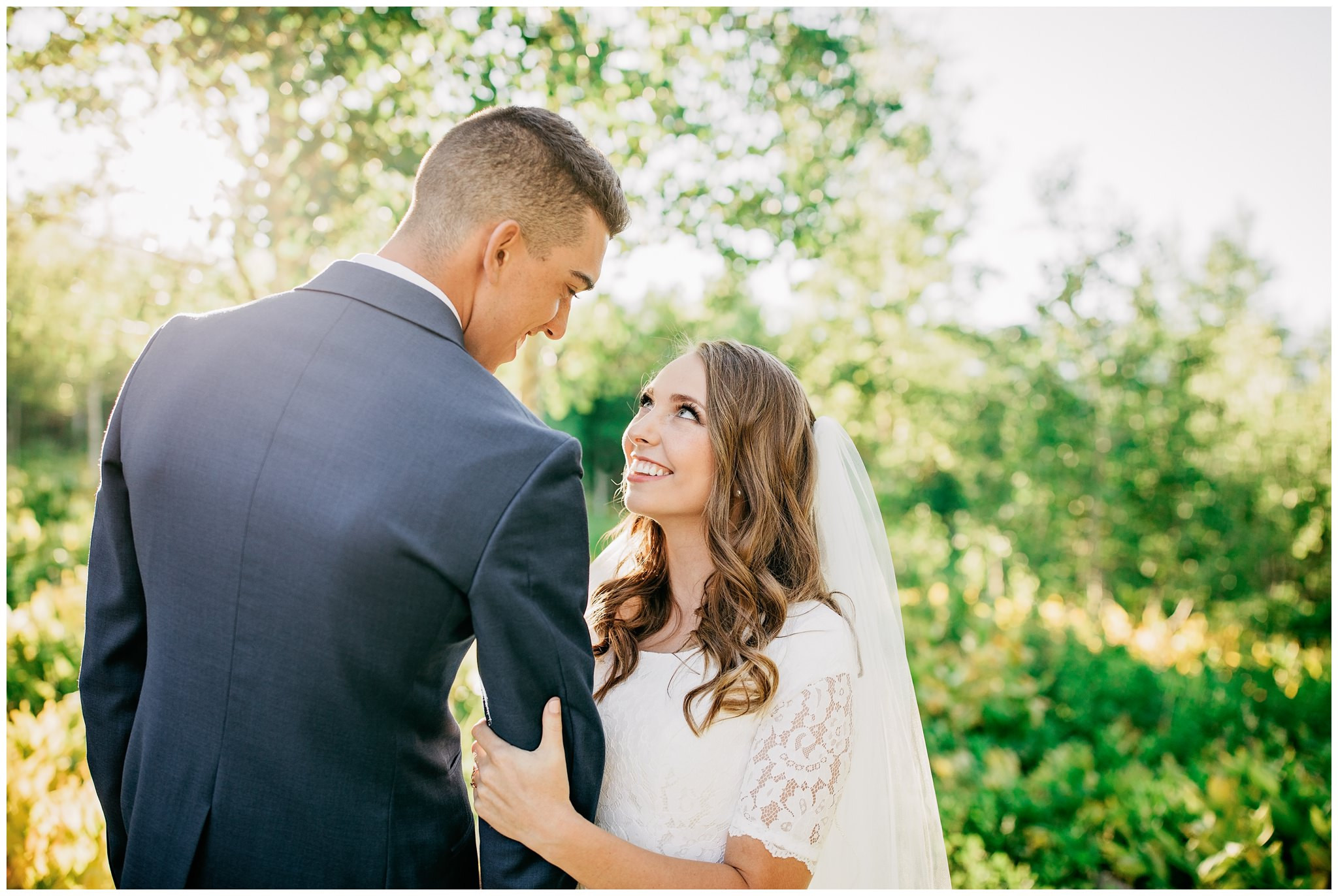 Bride and groom in mountains near aspen tree for their bridals