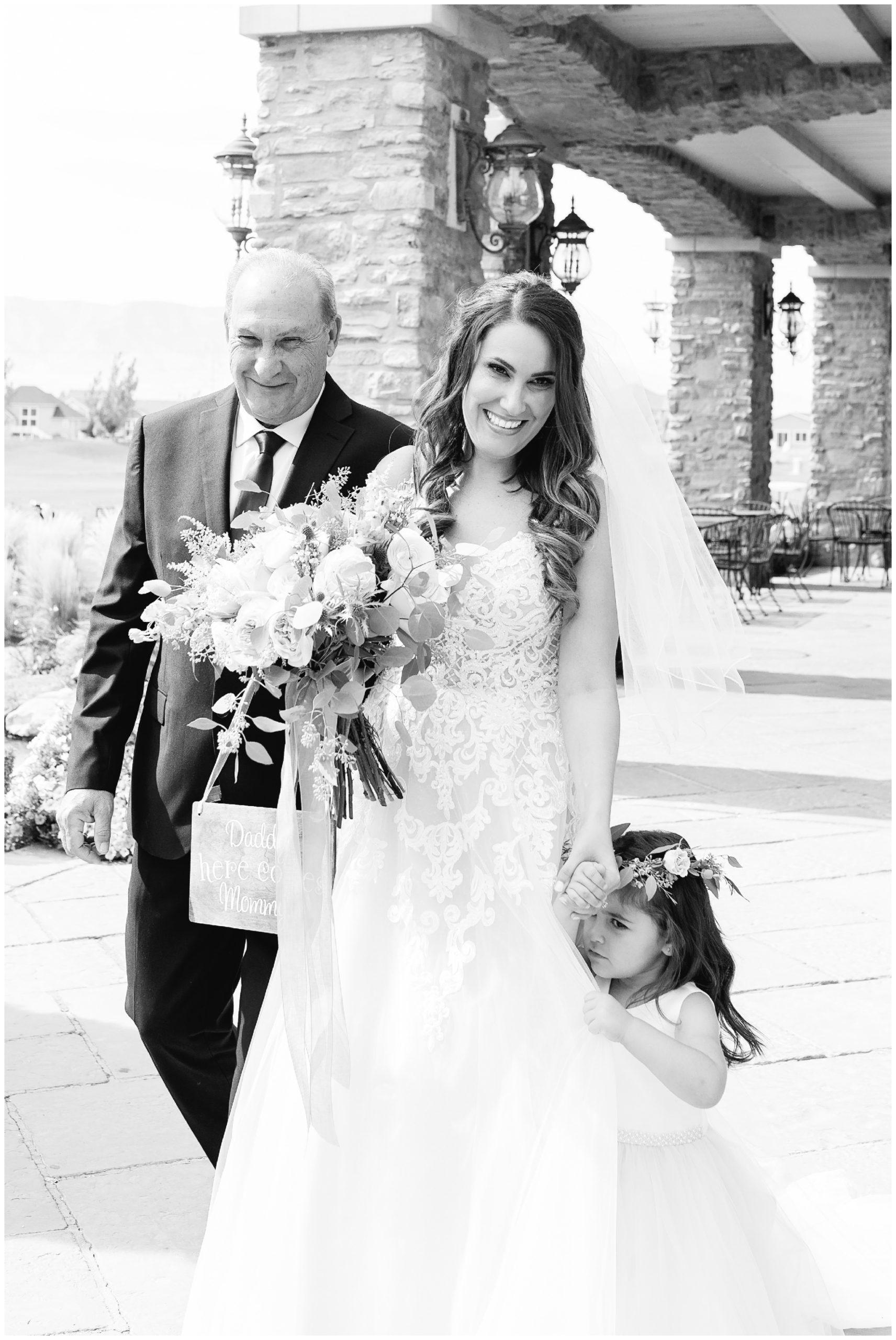 Bride walking down aisle at her Sleepy Ridge wedding in Vineyard Utah