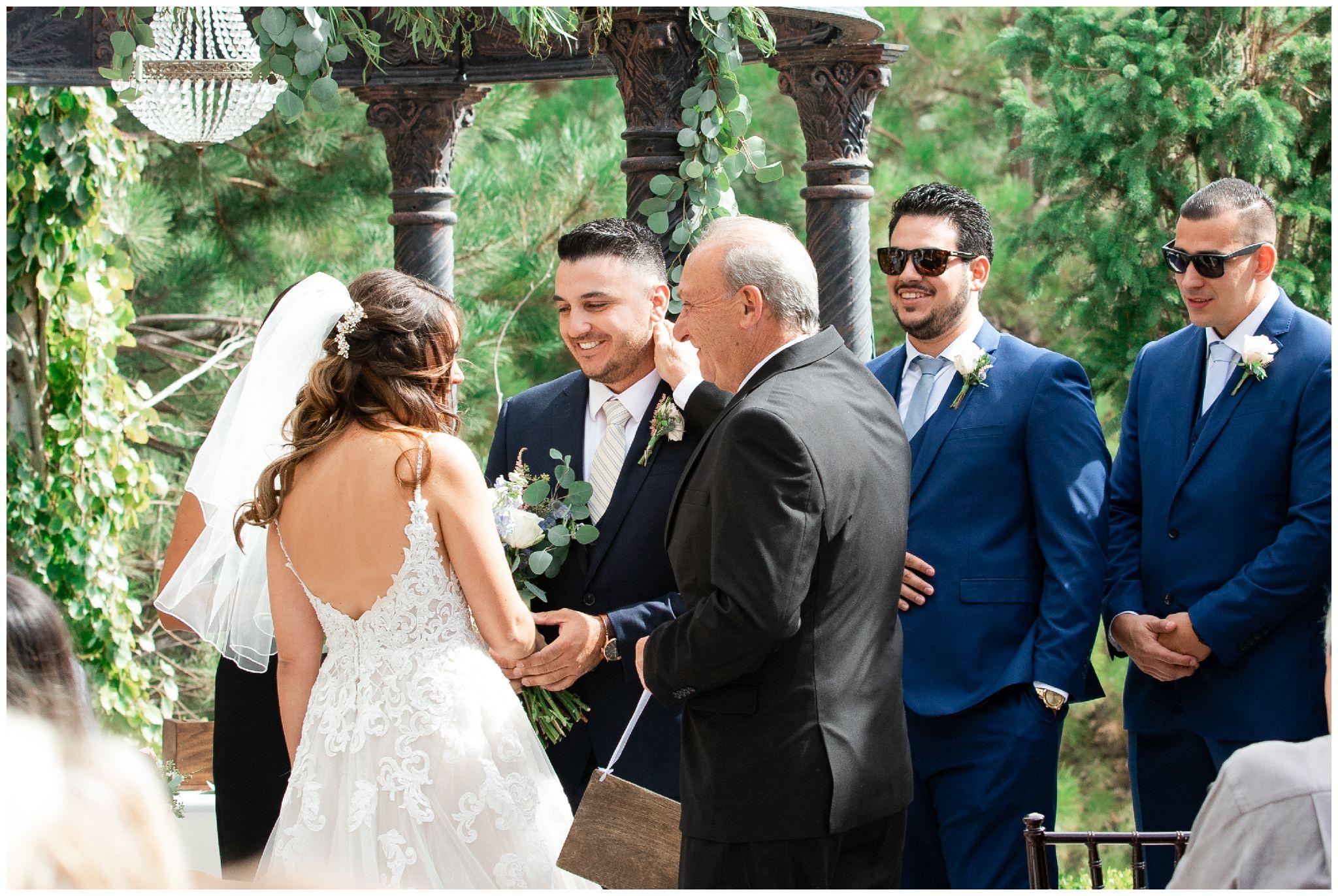 Wedding ceremony outside at Sleepy Ridge Wedding Venue in Vineyard Utah
