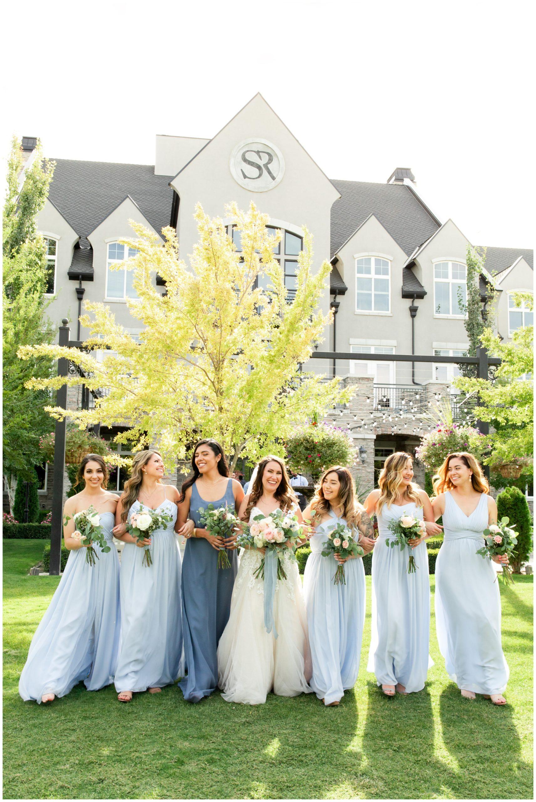 Bridesmaids wearing light blue dresses at wedding in Utah