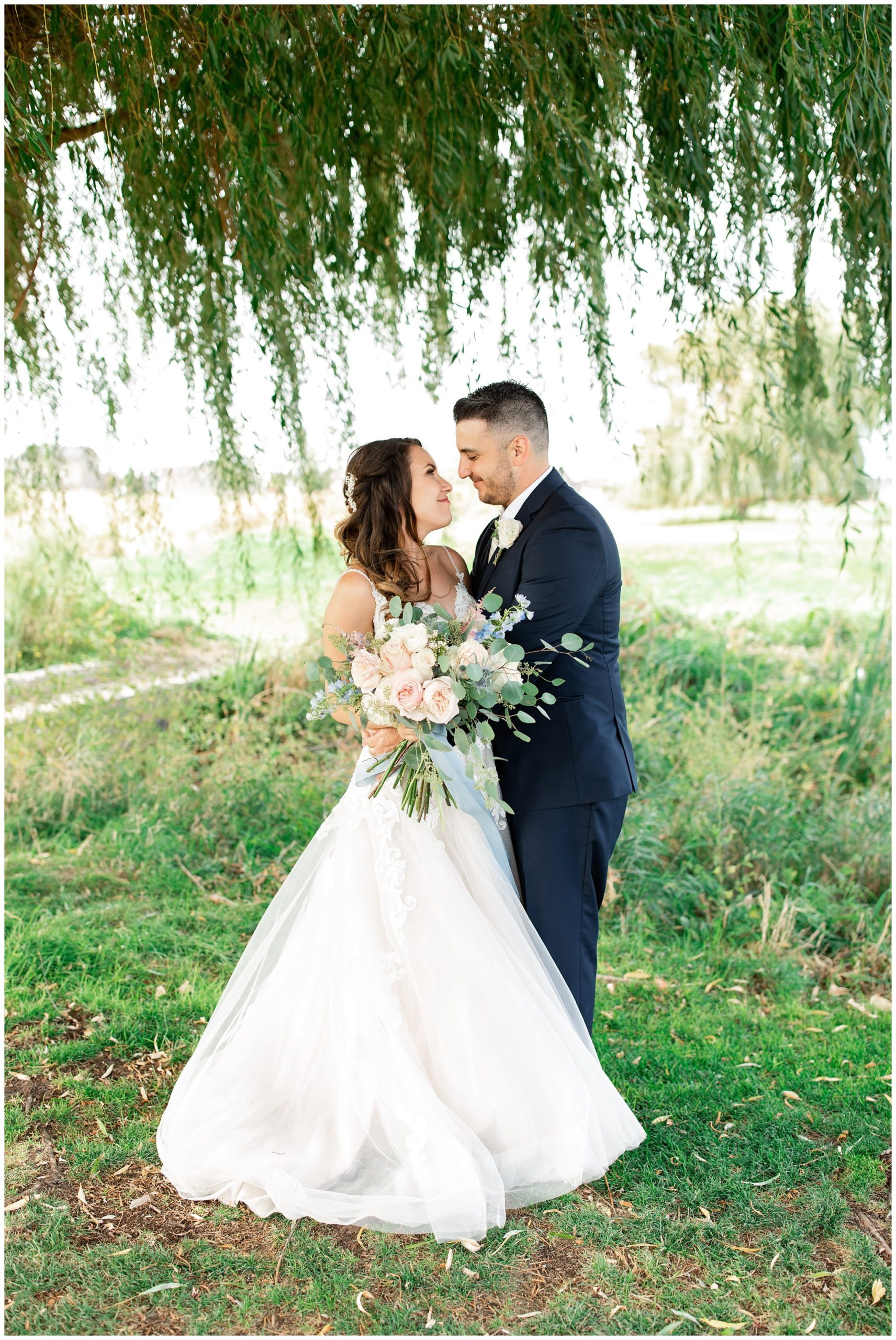 Bride and groom under the willow tree at Sleepy Ridge