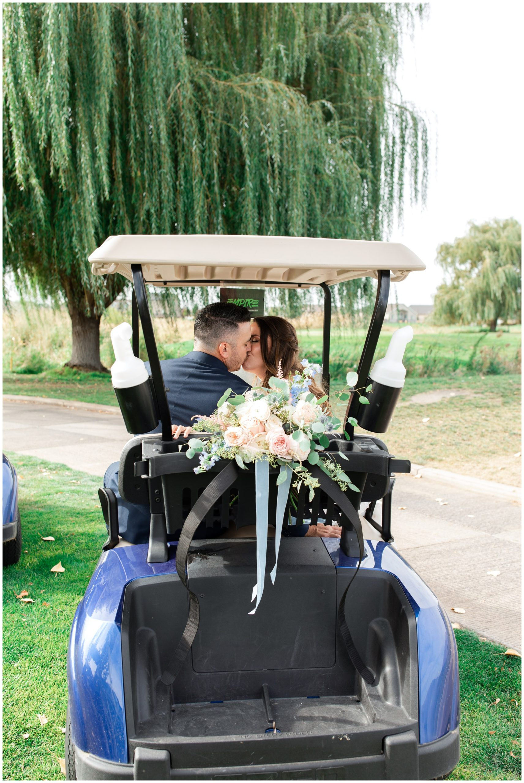 Bride and groom riding in golf cart at the Link of Sleepy Ridge