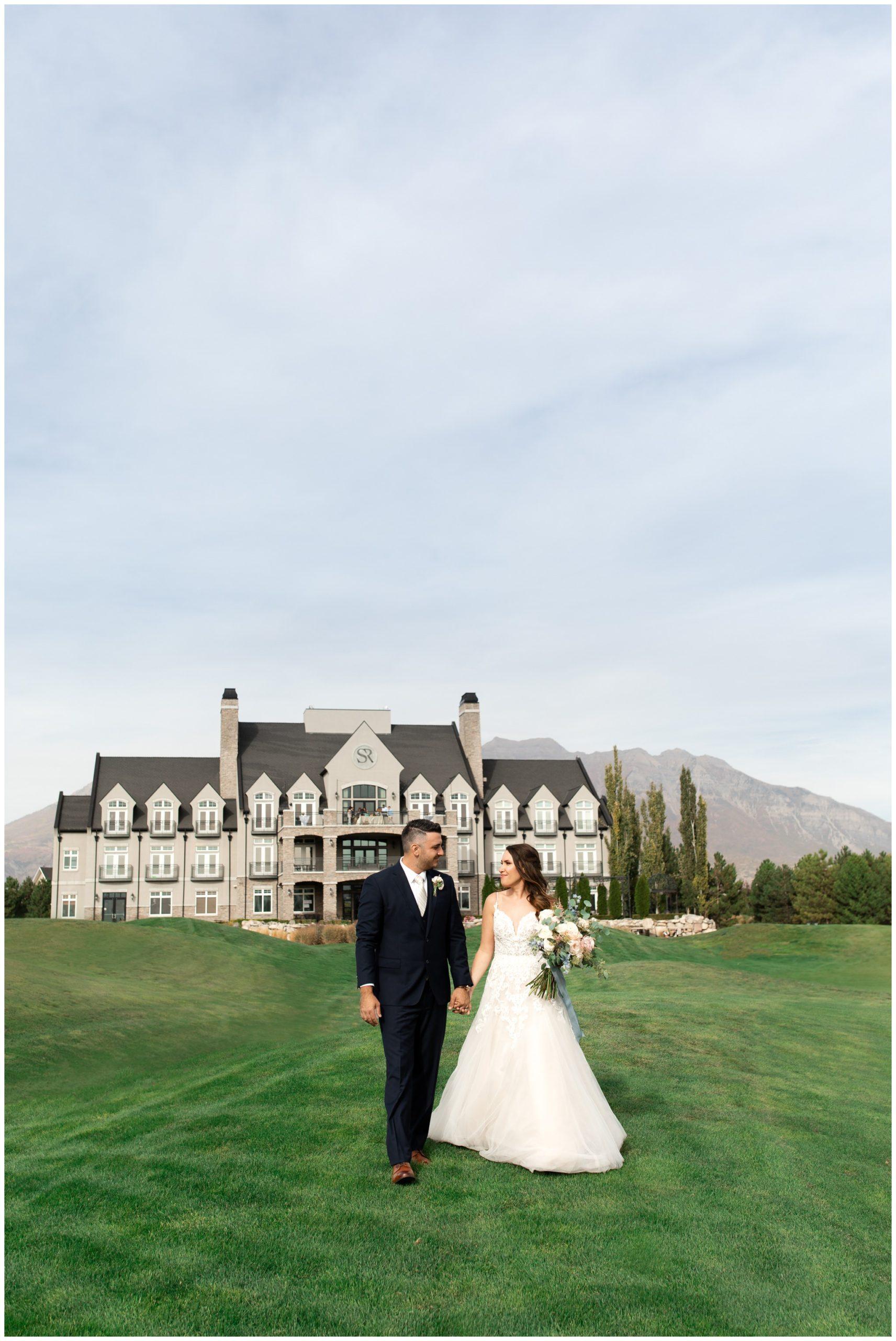 Bride and Groom posing in front of the Sleepy Ridge Wedding Venue