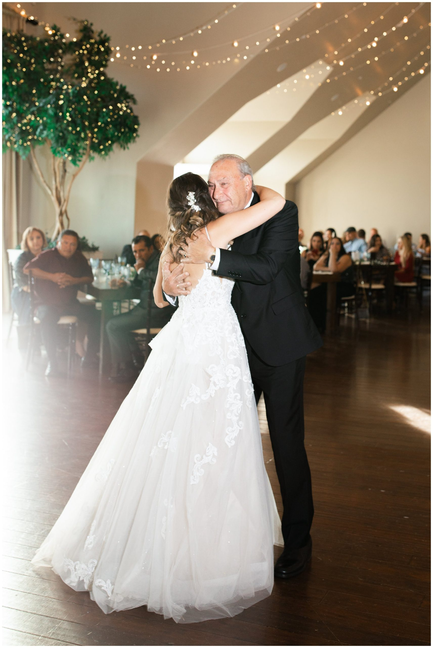 Bride dancing with her dad in the Sunset Room
