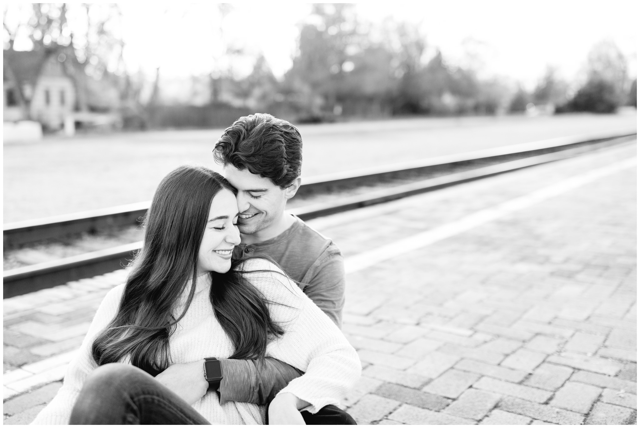 Black and white image of couple at the Boise Train depot for Winter Engagements