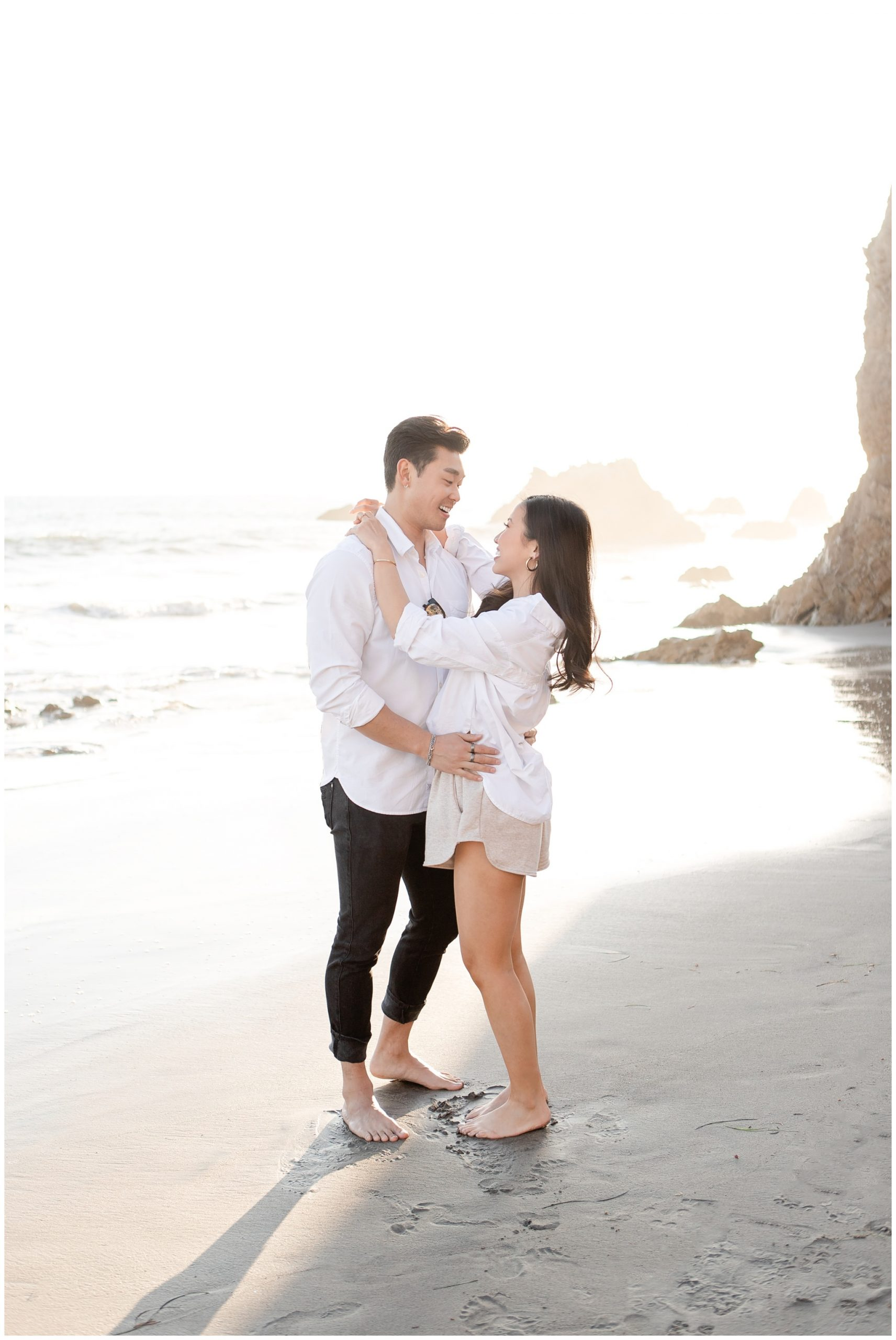 Engagement pictures on beach during sunset. CA