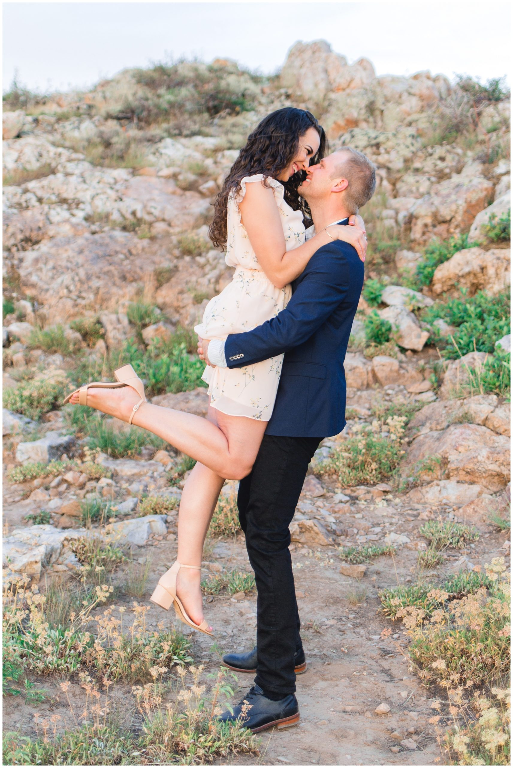 Groom lifting Bride for Engagement photos in Park City