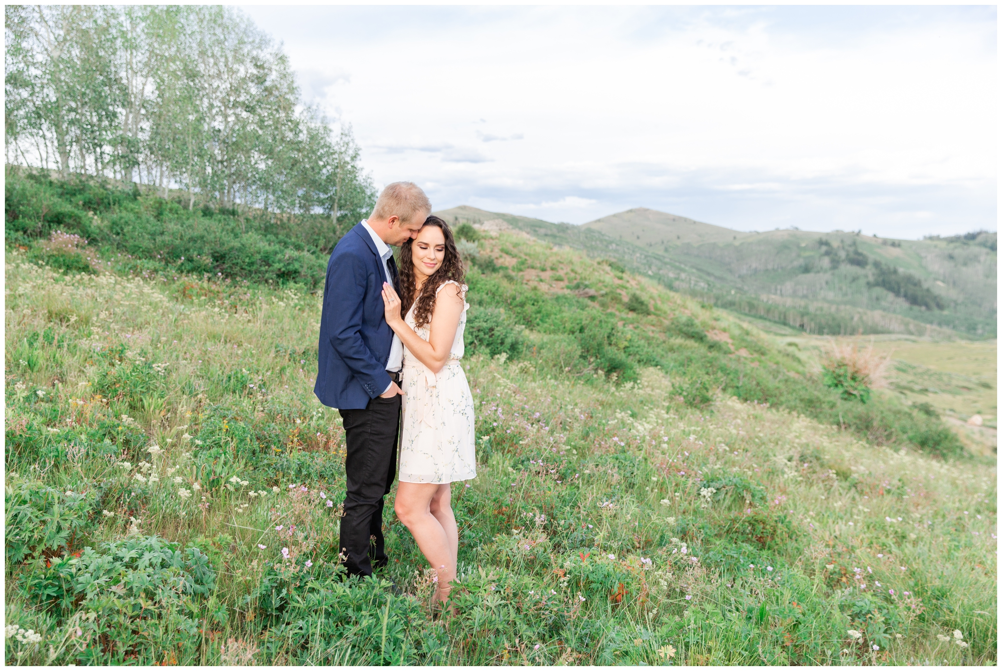 Wildflowers in Park City Utah with a couple posing for Engagement photos