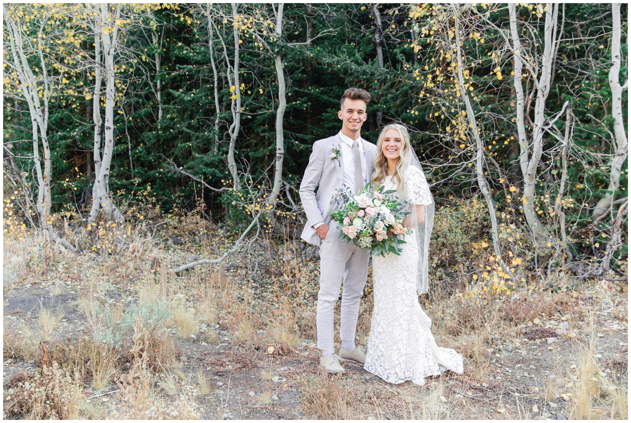 Bride and groom smiling at the camera at Jordan pines