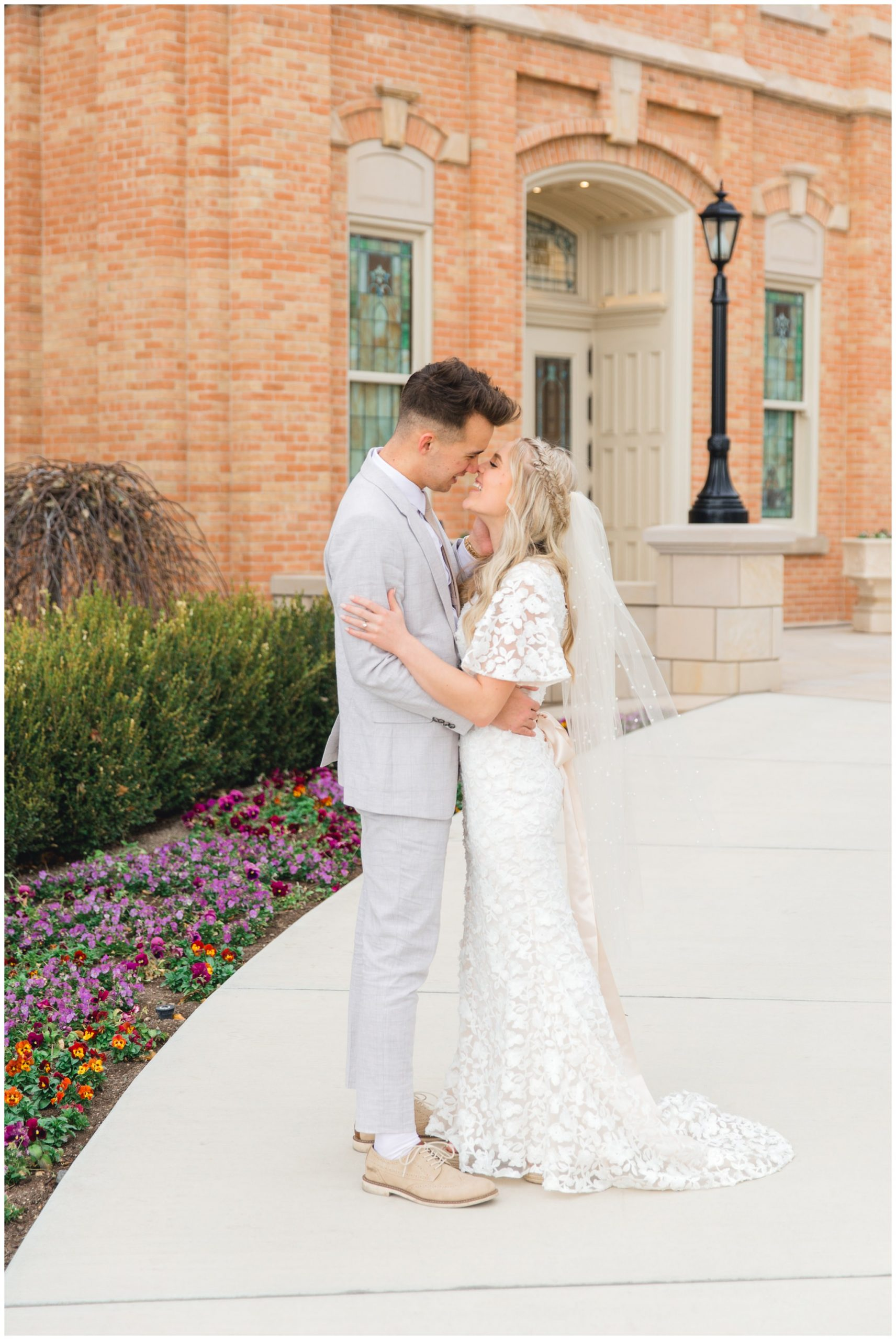 Bride and groom kissing at the Provo City Center Temple
