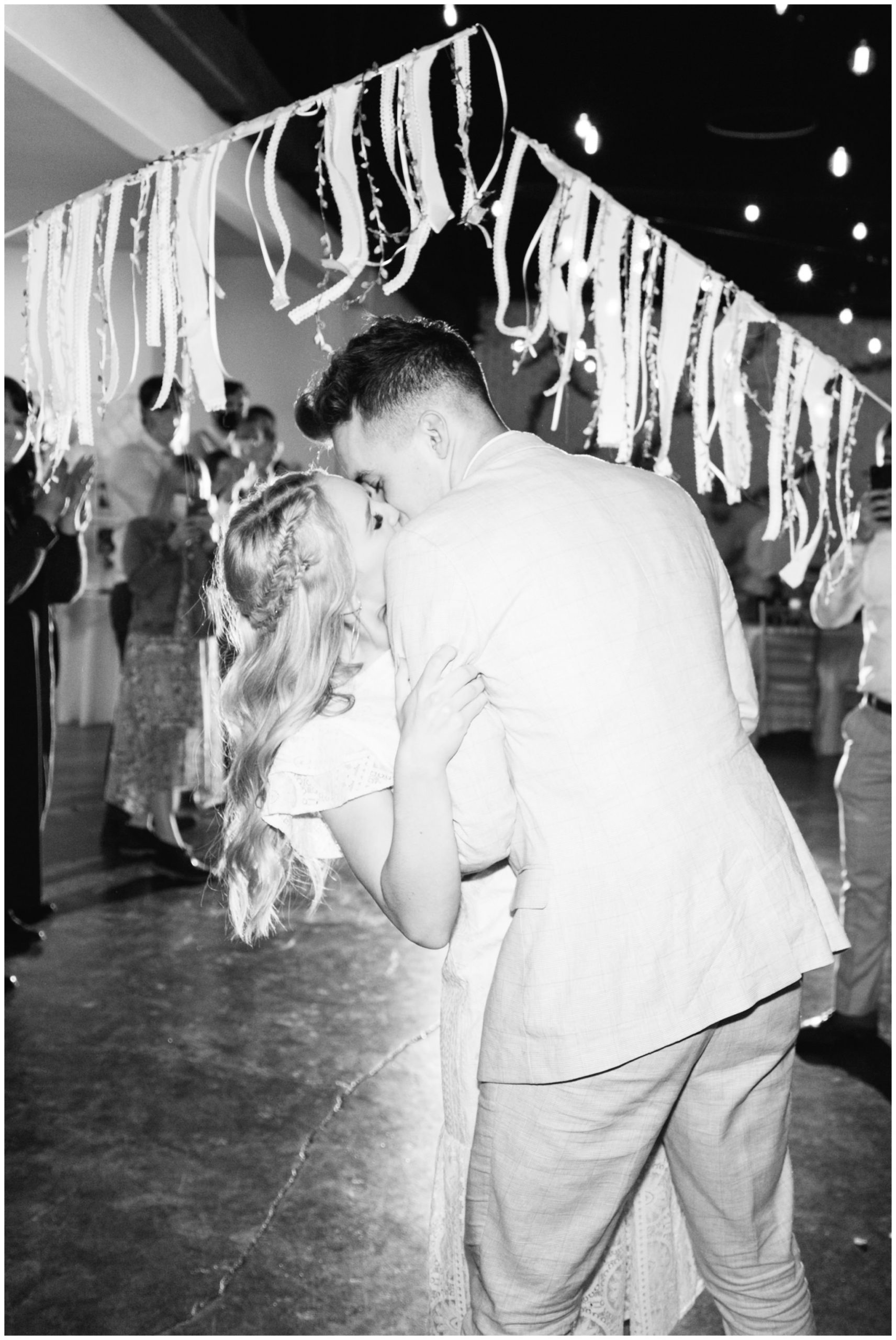 Bride and Groom kissing at their reception at the State House Venue in Orem, Utah