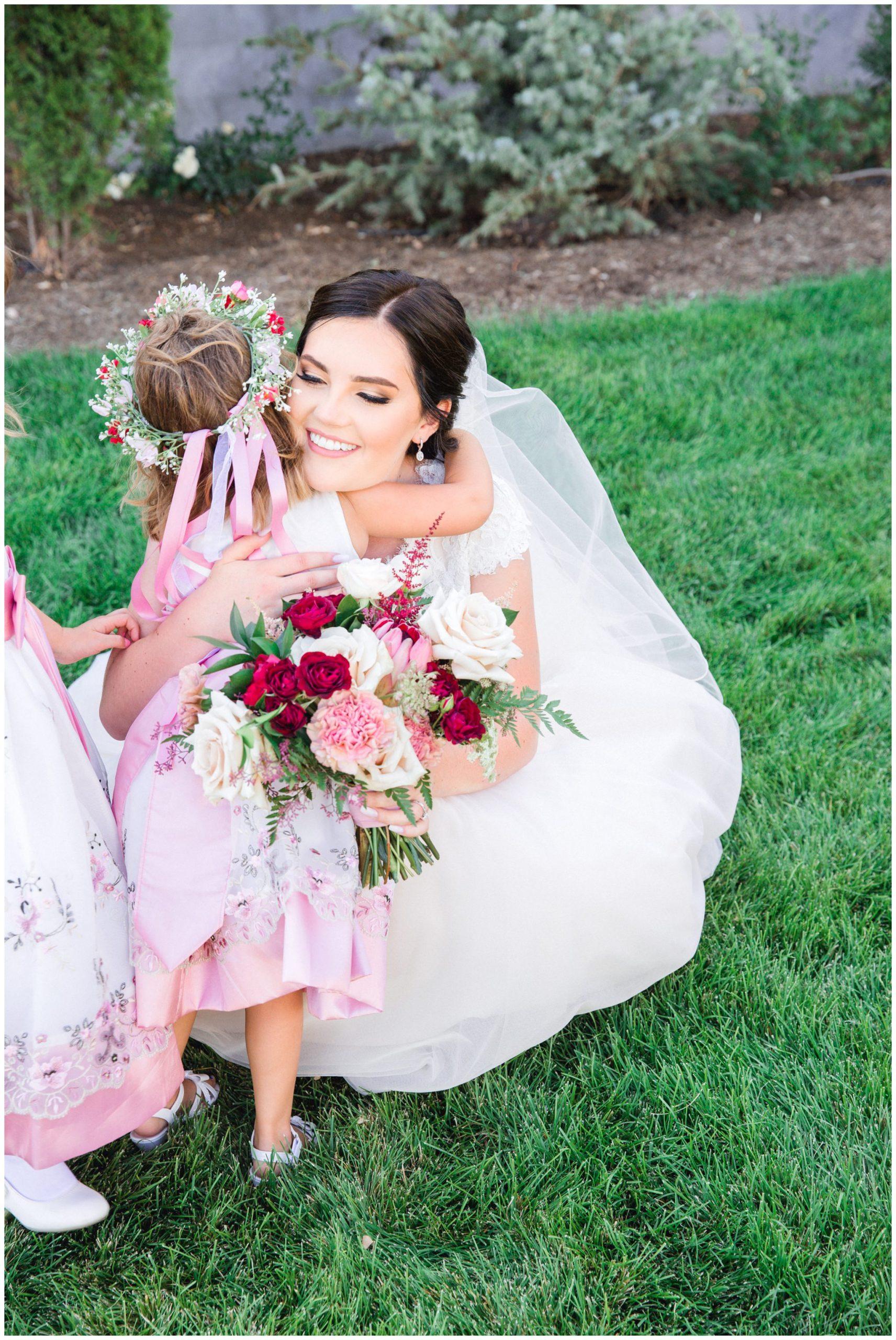 Bride hugging the flower girl at the wild oak wedding venue
