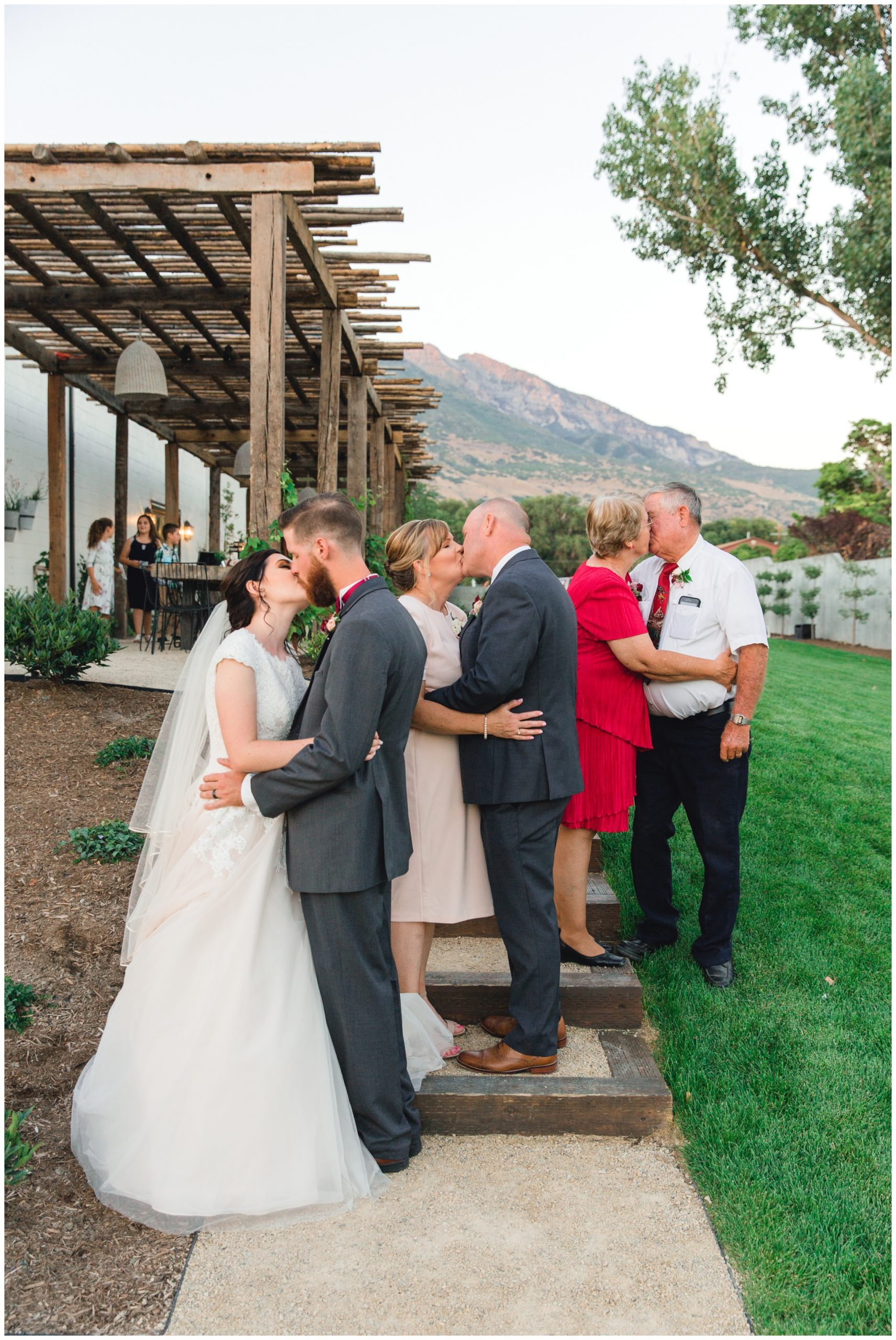 3 generations kissing their spouces. All of them share the same wedding date.