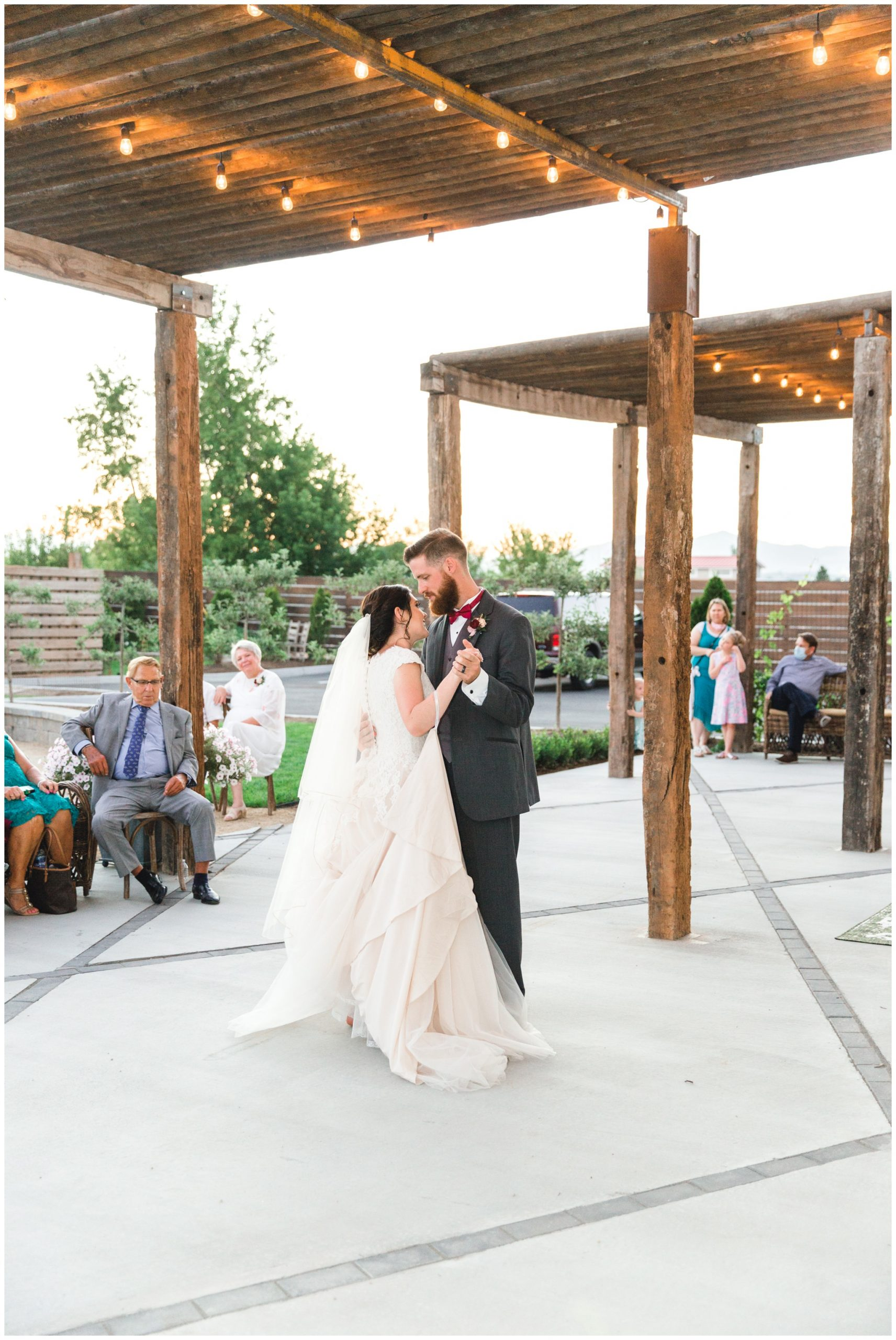Bride and groom sharing their first dance as husband and wife at their wedding reception in Lindon Utah