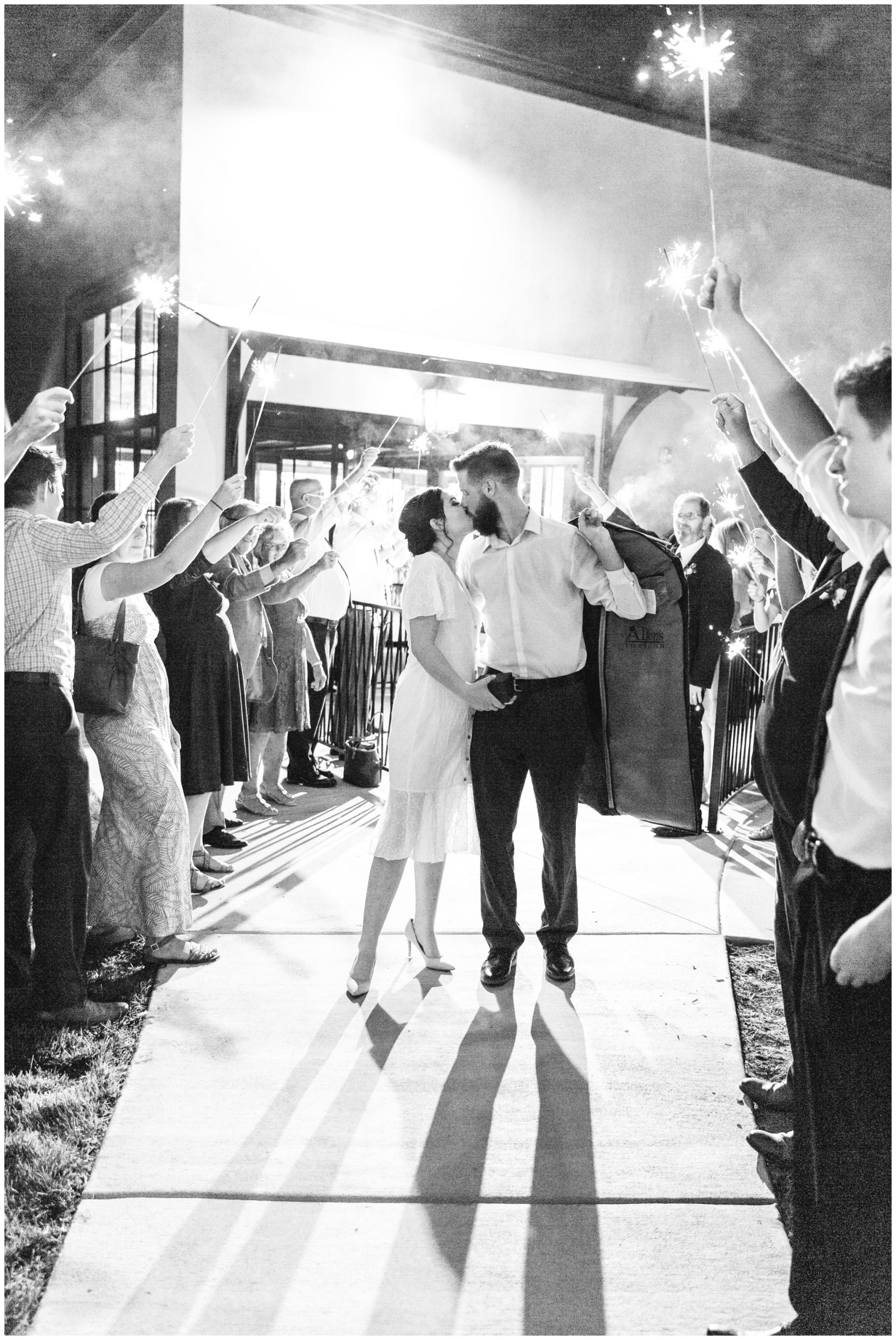 Bride and groom kissing during the sparkler exit at their wedding in Lindon Utah