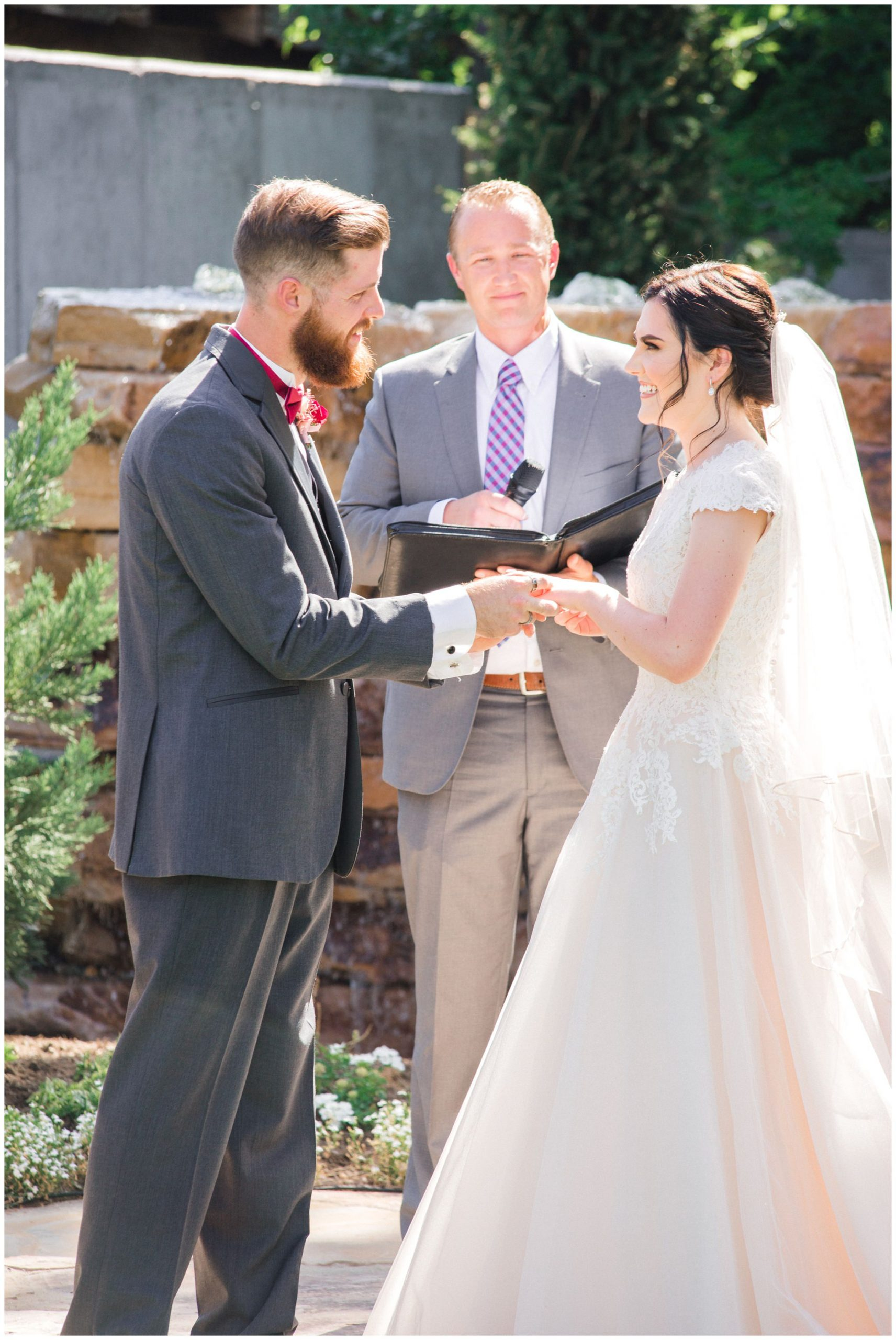 Bride and groom exchanging vows in Lindon utah at the Wild oak venue