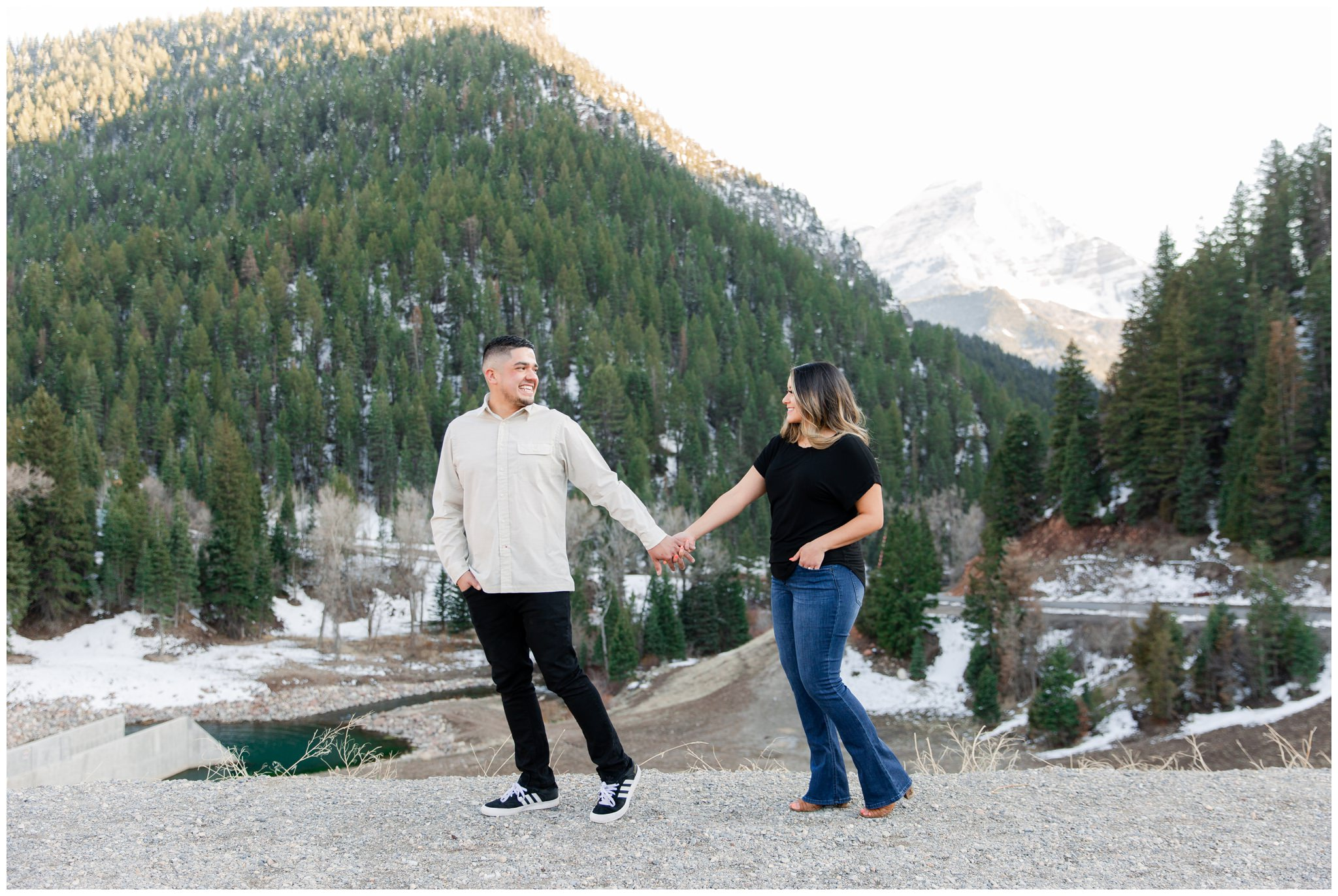 Couple holding hands in the mountains of Utah