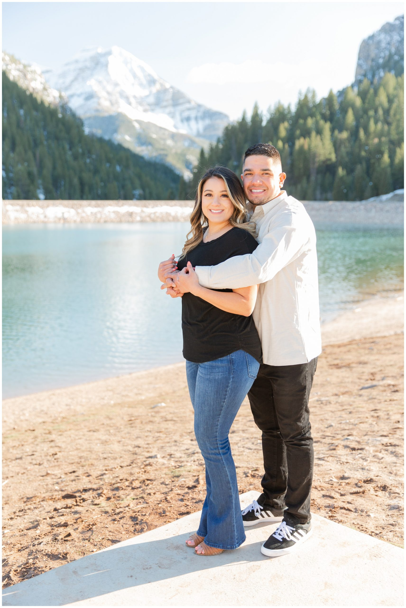 Couple posing by a lake in the mountains of Utah